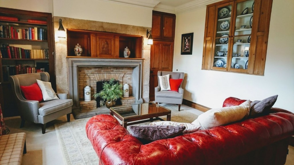 The study room at Elsick House with Chesterfield sofa and fireplace
