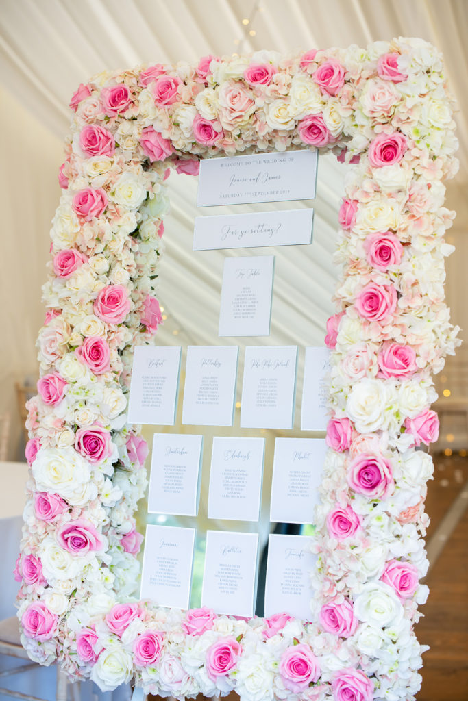 Wedding table plan with pink and white roses. Wedding Stationery