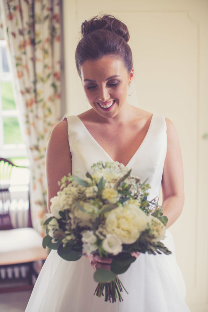 Bride with wedding bouquet of white flowers