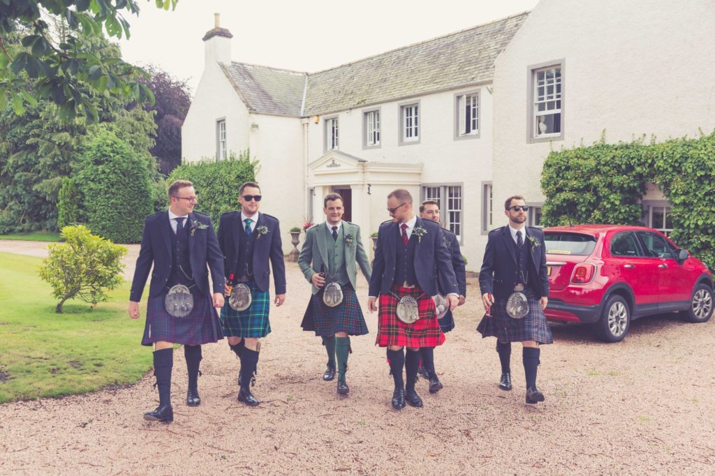 Groom and wedding party outside Elsick House.
