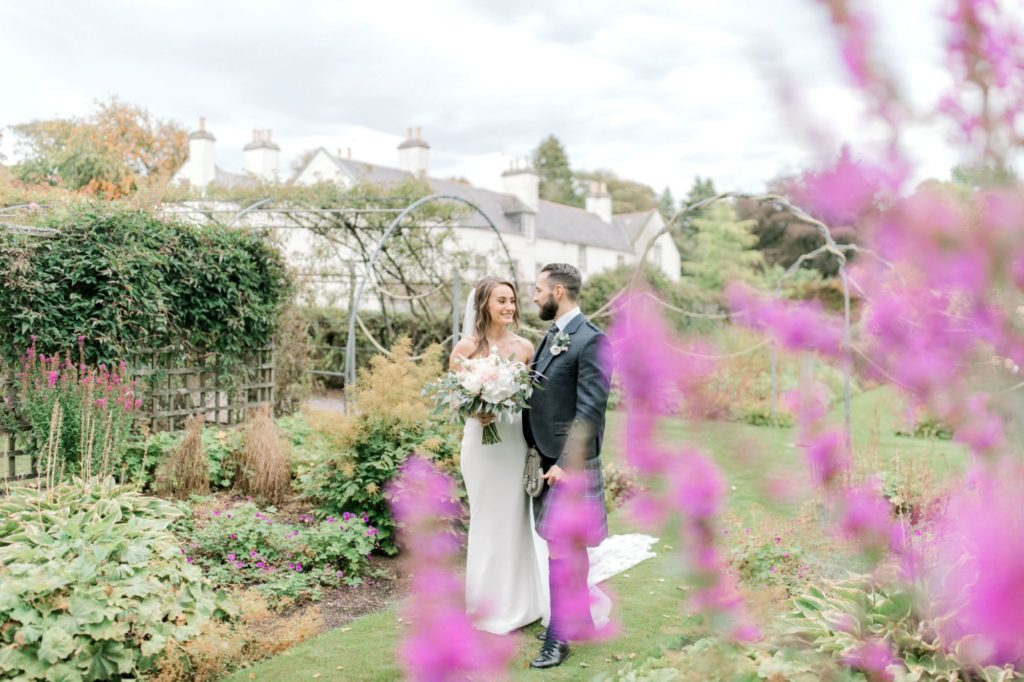 Bride and groom in the gardens following wedding at Elsick House