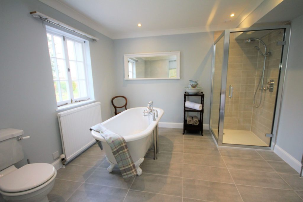 Ensuite bathroom with roll top bath and freestanding shower